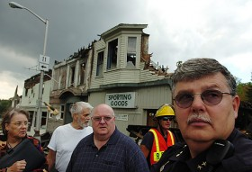 Officials gather in front the the remains of Milo's Main Street to assess the devastation caused by Sunday's early morning fire. From left to right are Gail Kelley, of Senator Snowe's office, Town Selectman Richard Mullins, Town Manager Jeff Gahagan, firefighter Wayne Russell, and Police Chief Michael Poulin.